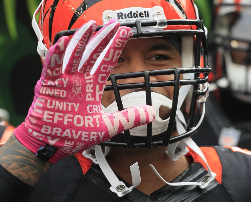 Cincinnati Bengals middle linebacker Rey Maualuga wears a pink glove for breast cancer awareness during an NFL football game against the New England Patriots, Sunday, Oct. 6, 2013, in Cincinnati. (AP Photo/Tom Uhlman)