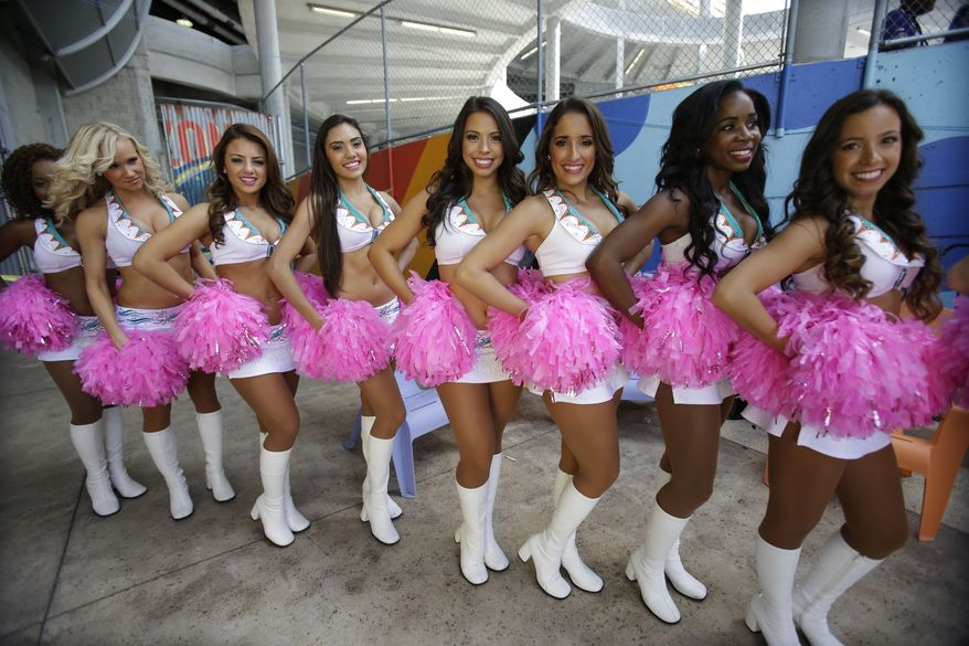 Miami Dolphins cheerleaders dressed in pink for Breast Cancer Awareness Month get ready to perform before an NFL football game against the Baltimore Ravens, Sunday, Oct. 6, 2013, in Miami Gardens, Fla. (AP Photo/Wilfredo Lee)