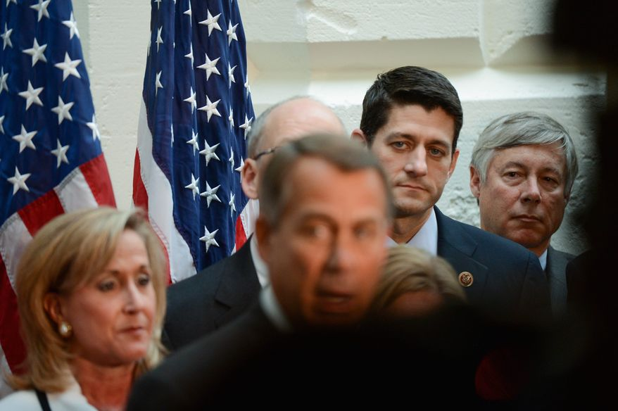 """Rep. Paul Ryan wrote an op-ed proposing to couple an increase in the government's debt ceiling with """"common-sense reforms of the country's entitlement programs and tax code,"""" but grass-roots activists said he failed to mention Obamacare. (Andrew Harnik/The Washington Times)"""