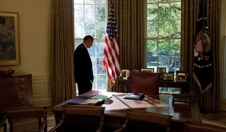 President Barack Obama walks to his desk in-between meetings in the Oval Office, Oct. 20, 2009. (Official White House Photo by Pete Souza)
