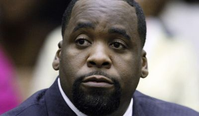 ** FILE ** In this May 25, 2010, file photo, former Detroit Mayor Kwame Kilpatrick sits at his sentencing in Wayne County Circuit Court on an obstruction-of-justice conviction. (AP Photo/Paul Sancya, File)