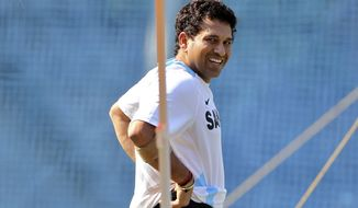 FILE - In this Nov. 20, 2011 file photograph, India's Sachin Tendulkar smiles during a training session ahead of their third test cricket match against West Indies in Mumbai, India. Tendulkar said Thursday, Oct. 10, 2013, he will retire from international cricket after playing his 200th test match next month. (AP Photo/Rajanish Kakade, File)