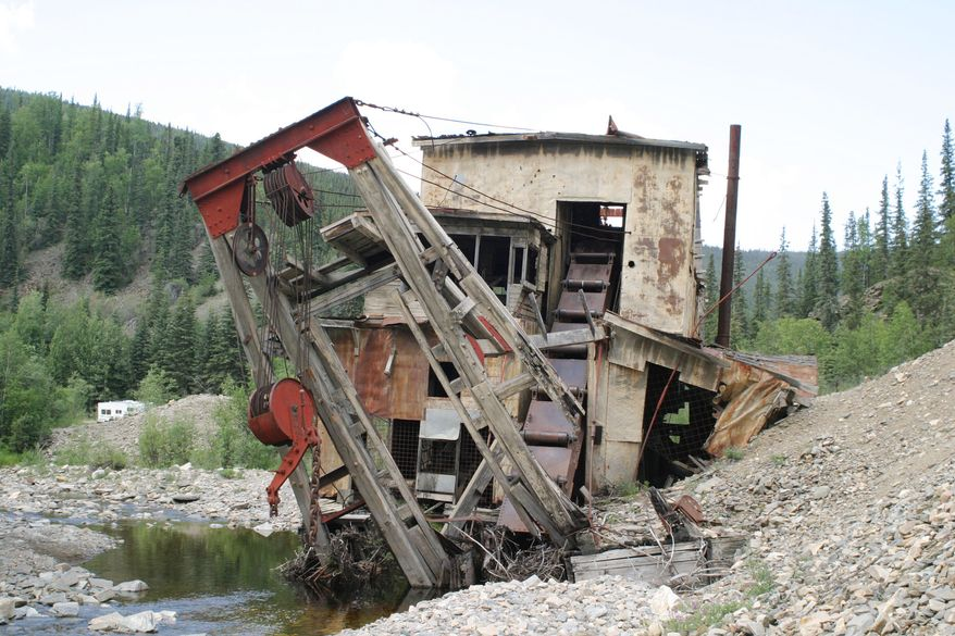 **FILE** The Jack Wade gold dredge sits on Wade Creek along the Taylor Highway north of Chicken, Ala., on June 30, 2005. The dredge, once used for gold mining and later a popular tourist stop along the highway, was demolished in September 2007 by the Bureau of Land Management because of safety concerns. (Associated Press)