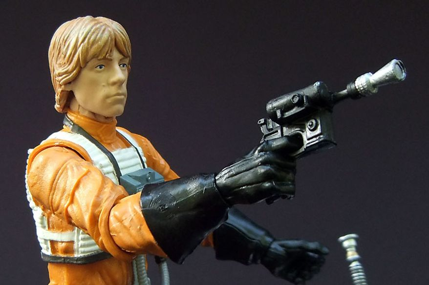 Blaster and flight suit detail on Hasbro's Star Wars: The Black Series, Luke Skywalker action figure. (Photo by Joseph Szadkowski/The Washington Times)