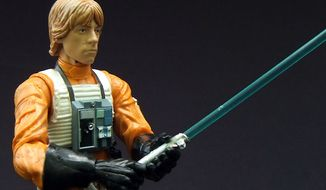 ** FILE ** Lightsaber and flight suit detail on Hasbro's Star Wars: The Black Series, Luke Skywalker action figure. (Photo by Joseph Szadkowski/The Washington Times)