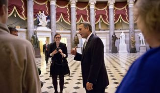 House Speaker John Boehner of Ohio stops to greet visitors from Panama City, Fla., guests of Rep. Steve Southerland, R-Fla., in Statuary Hall on Capitol Hill in Washington, Friday, Oct. 11, 2013.  After weeks of ultimatums, President Barack Obama and congressional Republicans are exploring whether they can end a budget standoff that has triggered a partial government shutdown and edged Washington to the verge of a historic, economy-jarring federal default.  (AP Photo/J. Scott Applewhite)