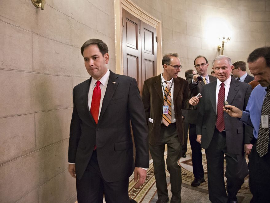 Sen. Marco Rubio, R-Fla. passes at left as  Sen. Jeff Sessions, R-Ala., right, talks with reporters on Capitol Hill in Washington, Friday, Oct. 11, 2013, as Republican returned to the Capitol after a two-hour meeting at the White House with President Barack Obama, trying to come up with a bipartisan solution to the budget stalemate.  (AP Photo/J. Scott Applewhite)