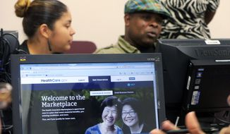 Parkland Memorial Hospital financial counselor Tiffany Ruiz, left, helps Vyncent Bosh sign up for insurance under the Affordable Care Act on Friday, Oct. 11, 2013, in Dallas. (AP Photo/The Dallas Morning News, Ron Baselice)