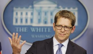 White House press secretary Jay Carney throws his hands up when asked about President Obama's plans for the following week during his daily news briefing at the White House in Washington, Friday, Oct. 11, 2013. Carney took questions regarding the budget and partial government shutdown. (AP Photo/Pablo Martinez Monsivais)