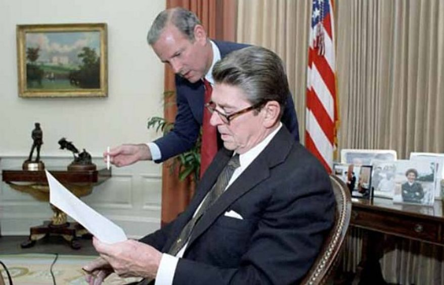 President Ronald Reagan (seated) and Chief of Staff James A. Baker III are pictured in the Oval Office of the White House. (University of Texas)