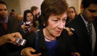 Sen. Susan Collins, R-Maine, is followed by reporters as she leaves a meeting of Senate Republicans regarding the government shutdown and debt ceiling on Capitol Hill in Washington, Saturday, Oct. 12, 2013. (AP Photo/Charles Dharapak)