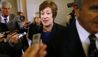 ** FILE ** Sen. Susan Collins, R-Maine, is followed by reporters as she leaves a meeting of Senate Republicans regarding the government shutdown and debt ceiling on Capitol Hill in Washington, Saturday, Oct. 12, 2013. (AP Photo/Charles Dharapak)