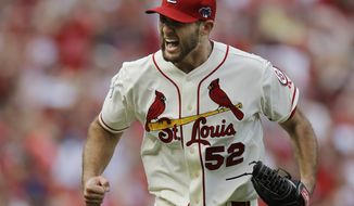 St. Louis Cardinals starting pitcher Michael Wacha celebrates after striking out Los Angeles Dodgers' Juan Uribe with bases loaded to end the sixth inning of Game 2 of the National League baseball championship series Saturday, Oct. 12, 2013, in St. Louis. (AP Photo/Jeff Roberson)