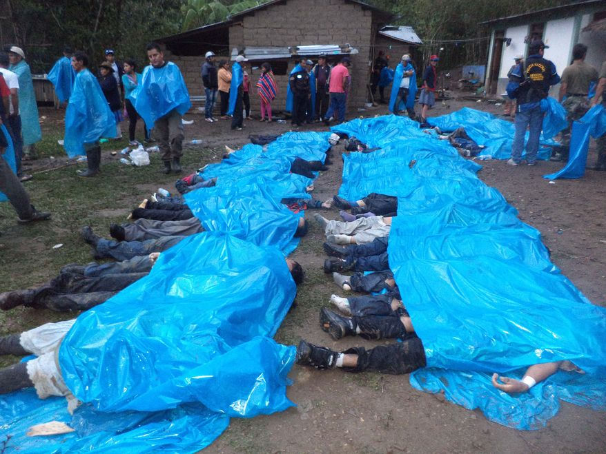 Bodies of victims lie under plastic sheets after they were recovered from a cliff near the twon of Santa Teresa, Cuzco province, Peru, Saturday, Oct. 12, 2013. A makeshift bus carrying 51 Quechua Indians back from a party plunged off a cliff into a river Friday night near the provincial capital of Santa Teresa, an area about 310 miles (500 kilometers) southeast of Lima, killing everyone on board, including 14 children according to Santa Teresa police.(AP Photo/La Republica Newspaper)