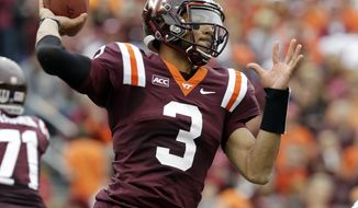 Virginia Tech quarterback Logan Thomas (3) tosses a pass during the first half of an NCAA college football game against Pittsburgh in Blacksburg, Va., Saturday, Oct. 12, 2013.  (AP Photo/Steve Helber)