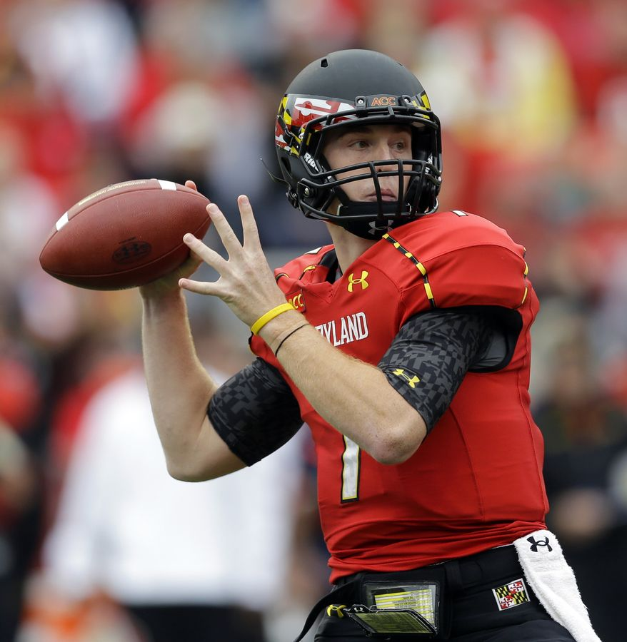 Maryland quarterback Caleb Rowe prepares to pass in the first half of an NCAA college football game against Virginia in College Park, Md., Saturday, Oct. 12, 2013. (AP Photo/Patrick Semansky)