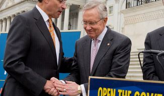 "Senate Majority Leader Harry Reid shakes hands with D.C. Mayor Vincent Gray. The senator from Nevada told Mr. Gray, ""I'm on your side. Don't screw it up."" (Associated Press)"
