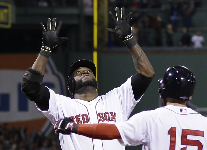Boston Red Sox's David Ortiz celebrates with Dustin Pedroia after hitting a grand slam home run in the eighth inning during Game 2 of the American League baseball championship series against the Detroit Tigers Sunday, Oct. 13, 2013, in Boston. (AP Photo/Matt Slocum)
