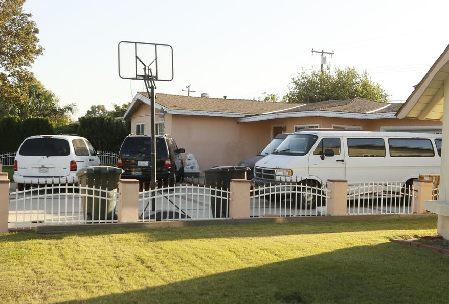 The home of the family of Sinh Vinh Ngo Nguyen is seen in Garden Grove, Calif., on Oct. 11, 2013. Sinh Vinh Ngo Nguyen, 24, of Garden Grove, was arrested earlier in the day in Santa Ana, Calif., while waiting to board a bus to Mexico, the FBI said in a statement. He was charged with attempting to provide material support to al Qaeda and lying on a U.S. passport application to facilitate an act of terrorism. (Associated Press)