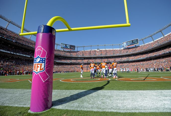 The south goal post at Sports Authority Field at Mile High Stadium is wrapped with a cover commemorating Breast Cancer Awareness Month in the first quarter of an NFL football game between the Denver Broncos and Jacksonville Jaguars, Sunday, Oct. 13, 2013, in Denver. (AP Photo/Jack Dempsey)