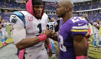 Minnesota Vikings running back Adrian Peterson, right, shakes hands with  Carolina Panthers quarterback Cam Newton following a 35-10 Panthers win in an NFL football game in Minneapolis, Sunday, Oct. 13, 2013. One of Peterson's sons, a 2-year-old in South Dakota, died Friday after an alleged attack in a child abuse case.(AP Photo/Ann Heisenfelt)