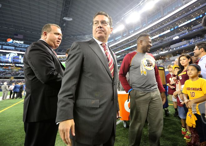 Washington Redskins owner Daniel Snyder visits with fans before an NFL football game against the Dallas Cowboys, Sunday, Oct. 13, 2013, in Arlington, Texas. (AP Photo/LM Otero)