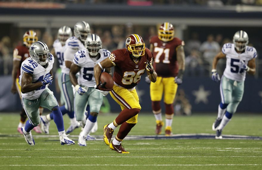 Washington Redskins tight end Jordan Reed (86) carries the ball and is chased by Dallas Cowboys free safety Barry Church (42) and outside linebacker Bruce Carter (54) in the first half of an NFL football game, Sunday, Oct. 13, 2013, in Arlington, Texas. (AP Photo/LM Otero)