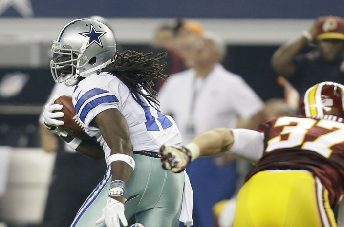 Dallas Cowboys wide receiver Dwayne Harris (17) escapes a tackle attempt by Washington Redskins' Reed Doughty (37) on a punt return in the second half of an NFL football game, Sunday, Oct. 13, 2013, in Arlington, Texas. (AP Photo/Tim Sharp)