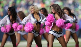Seattle Seahawks Sea Gals cheerleaders perform with pink boots and pom poms for breast cancer awareness during an NFL football game between the Seattle Seahawks and the Tennessee Titans, Sunday, Oct. 13, 2013, in Seattle. (AP Photo/Scott Eklund)
