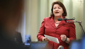 California Assemblywoman Toni Atkins, San Diego Democrat, urges lawmakers in Sacramento to approve her bill to allow nurse practitioners, certified nurse midwives and physician assistants to perform a type of abortion in the first trimester. By a 49-25 vote, the Assembly approved Ms. Atkins' bill and it was signed by Gov. Jerry Brown, a Democrat. (associated press)