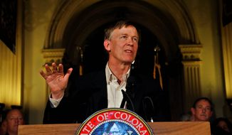 "Colorado Gov. John Hickenlooper said residents of his state ""don't really like outside organizations meddling in their affairs,"" referring to groups  from out of state that got involved in a pair of state Senate recall elections. Despite their help, two Democrats lost their seats over gun control. (Associated Press)"