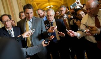 """Senate Majority Leader Harry Reid, Nevada Democrat, reported some progress Monday toward a deal to avoid a threatened default and end a two-week partial government shutdown. """"Everyone just needs to be patient. Perhaps tomorrow will be a bright day. We're not there yet,"""" he said. (Associated Press photographs)"""