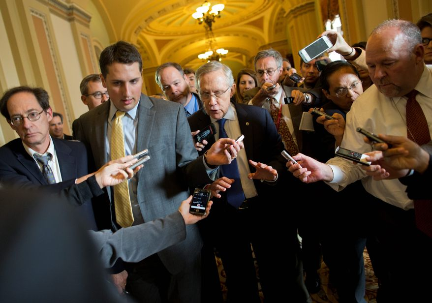 "Senate Majority Leader Harry Reid, Nevada Democrat, reported some progress Monday toward a deal to avoid a threatened default and end a two-week partial government shutdown. ""Everyone just needs to be patient. Perhaps tomorrow will be a bright day. We're not there yet,"" he said. (Associated Press photographs)"