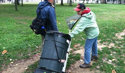 Phillip and Molly Feliciano spent Sunday collecting litter and trash that has piled up on the Mall since the start of the federal government shutdown. (meredith somers/the washington times)