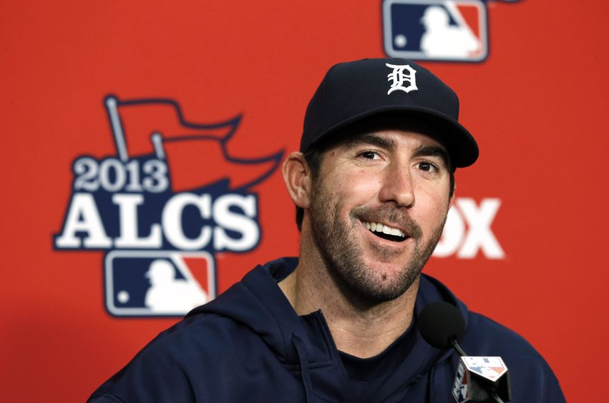 Detroit Tigers pitcher Justin Verlander smiles during a media availability at Comerica Park before practice for Game 3 of the American League baseball championship series against the Boston Red Sox in Detroit, Monday, Oct. 14, 2013. (AP Photo/Paul Sancya)