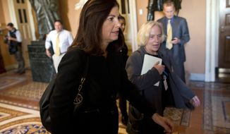 Sen. Kelly Ayotte, New Hampshire Republican, walks to a meeting with Senate Minority Leader Sen. Mitch McConnell, Kentucky Republican, on Capitol Hill in Washington on Monday, Oct. 14, 2013. (AP Photo/Evan Vucci)