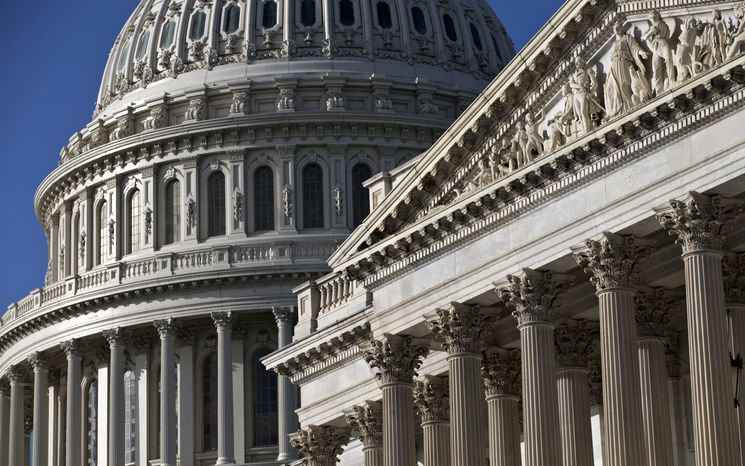 The Senate wing (right) and the Capitol Dome are seen on Capitol Hill in Washington on Monday, Oct. 14, 2013. (AP Photo/J. Scott Applewhite)