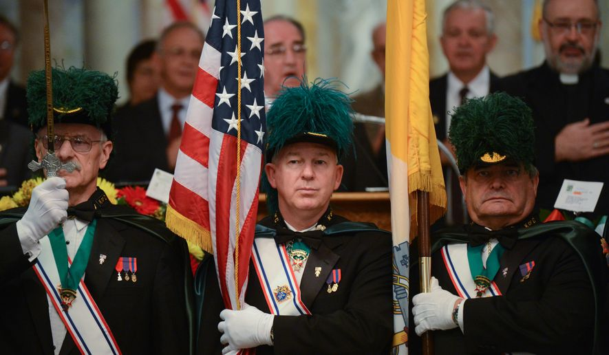 Members of the Knights of Columbus perform the presentation of colors at the beginning of the annual Columbus Day Wreath Laying which was held at the Columbus statue at Holy Rosary Church this year due to the ongoing government shutdown, Washington, D.C., Monday, October 14, 2013. (Andrew Harnik/The Washington Times)