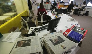 In this Oct. 4, 2013 photo shows a view of the newsroom of the International Herald Tribune, who will be rebranded as the International New York Times on Tuesday, Oct. 15, 2013 at the International Herald Tribune headquarters in Paris. The International Herald Tribune, a celebrated newspaper that long gave U.S. expatriates a cherished lifeline to events back home and a dose of Americana for foreign readers, published its last edition on Monday Oct. 14, 2013. It was 126 years old. (AP Photo/Michel Euler)
