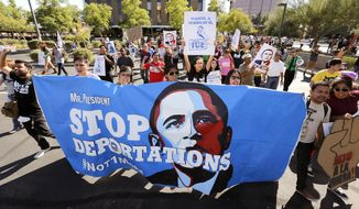 """Upset with President Barack Obama's immigration policy, about 250 people march to the U.S. Immigrations and Customs Enforcement office with a goal of stopping future deportations on Monday Oct. 14, 2013, in Phoenix.  The protesters chanted """"no more deportations"""" and """"shut down ICE."""" (AP Photo/Ross D. Franklin)"""