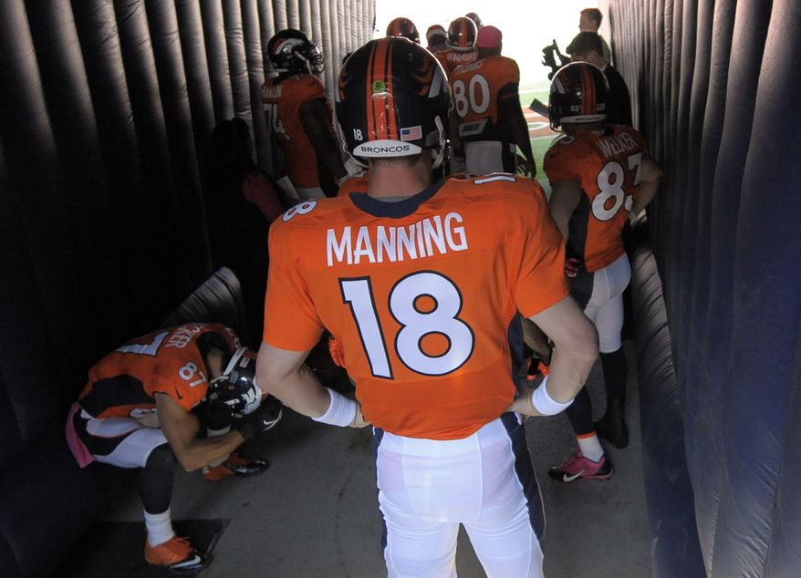 Denver Broncos quarterback Peyton Manning waits for introductions during an NFL football game against the Jacksonville Jaguars, Sunday, Oct. 13, 2013, in Denver. (AP Photo/Jack Dempsey)
