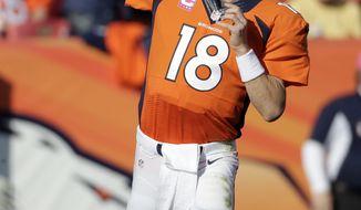 Denver Broncos quarterback Peyton Manning throws against the Jacksonville Jaguars during an NFL football game, Sunday, Oct. 13, 2013, in Denver. (AP Photo/Jack Dempsey)