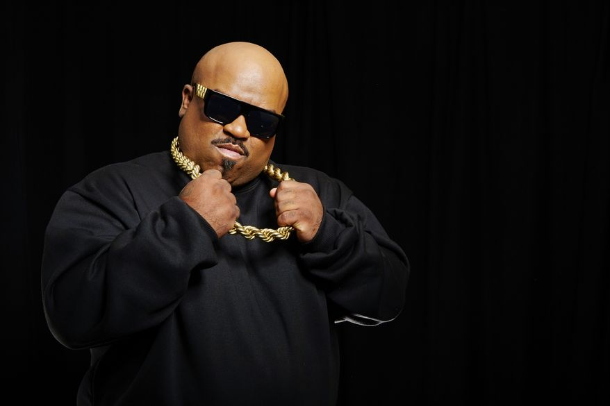 "Musician CeeLo Green poses for a portrait on Monday, Oct. 14, 2013, in New York to promote his singing competition series, ""The Voice."" (Dan Hallman/Invision/AP)"