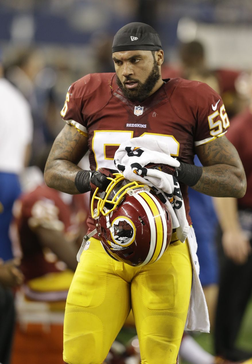 Washington Redskins inside linebacker Perry Riley (56) walks the sideline during the second half of an NFL football game against the Dallas Cowboys Sunday, Oct. 13, 2013, in Arlington, Texas. (AP Photo/LM Otero)