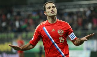 Russia's Roman Shirokov is during a World Cup Group F qualifying soccer match between Russia and Azerbaijan in Baku, Azerbaijan, Tuesday, Oct. 15, 2013. (AP Photo/Alexander Mysyakin)
