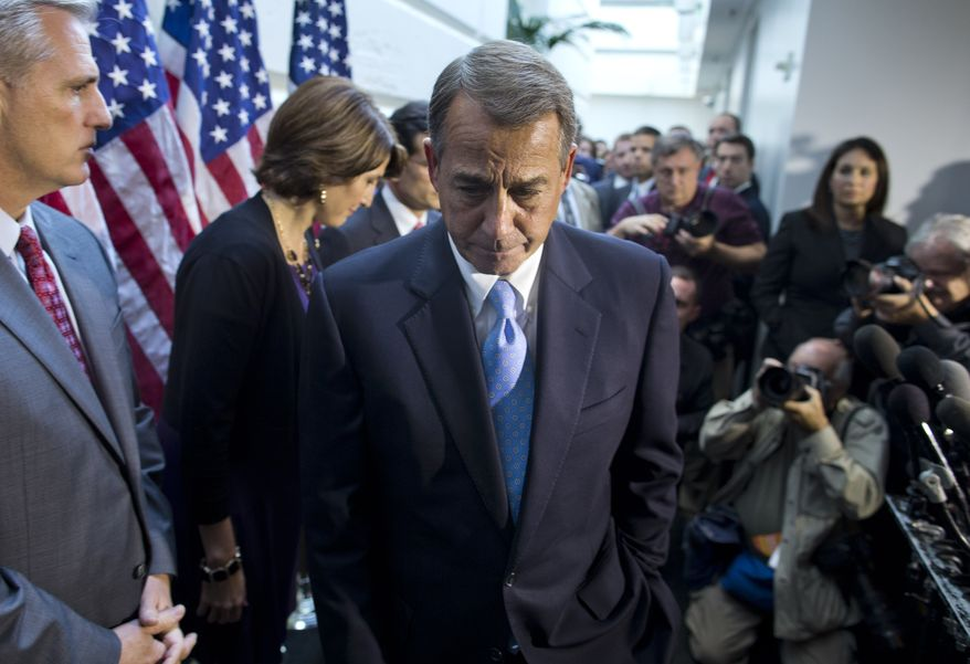 House Speaker John Boehner, R-Ohio, walks away from the microphone during a news conference after a House GOP meeting on Capitol Hill,  Tuesday, Oct. 15, 2013, in Washington. House GOP leaders Tuesday floated a plan to fellow Republicans to counter an emerging Senate deal to reopen the government and forestall an economy-rattling default on U.S. obligations. But the plan got mixed reviews from the rank and file, and it was not clear whether it could pass the chamber. (AP Photo/ Evan Vucci)