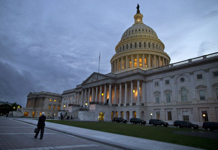 ** FILE ** A view of the U.S. Capitol building on Tuesday, Oct. 15, 2013 in Washington. (AP Photo/ Evan Vucci)