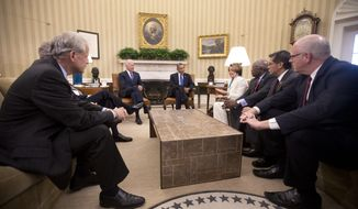 President Barack Obama, center, and Vice President Joe Biden, center left,  meet with Democratic Leadership in the Oval Office of the White House, Tuesday, Oct. 15, 2013, in Washington. Sitting with them are from left to right, Rep. Steve Israel, D-N.Y., House Minority Leader Nancy Pelosi of Calif., Rep. James Clyburn, D-S.C., Rep. Xavier Becerra, D-Calif., Rep. Joseph Crowley, D-N.Y. The partial government shutdown is in its third week and less than two days before the Treasury Department says it will be unable to borrow and will rely on a cash cushion to pay the country's bills. (AP Photo/Pablo Martinez Monsivais)