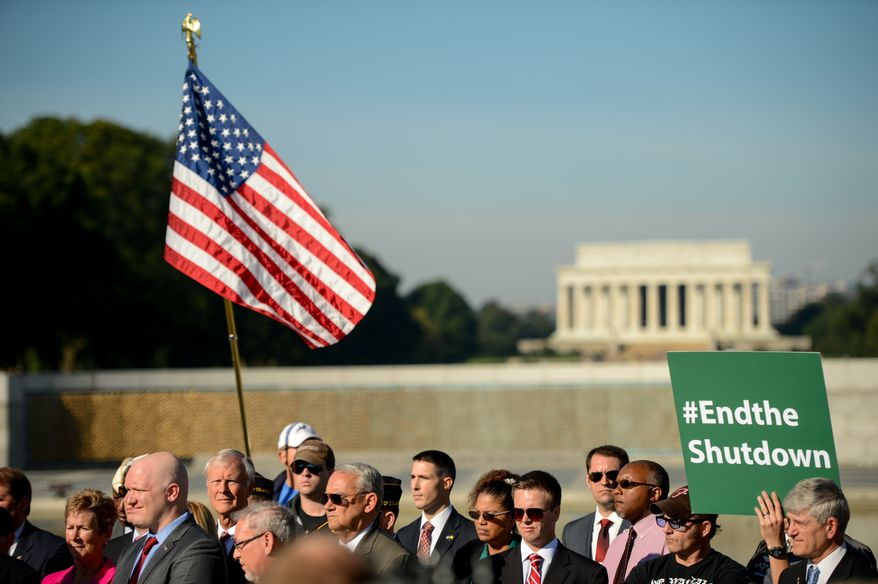 Veterans of Foreign Wars leaders and representatives of other veteran and military service organizations call for an end to the federal government shutdown at a rally at the World War II Memorial, Washington, D.C., Washington, D.C., Tuesday, October 15, 2013. (Andrew Harnik/The Washington Times)