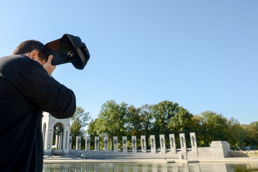 Retired Army Sgt. Steven Scalora of Woodbury, Conn. gets emotional as he looks out at the Lincoln Memorial following a rally for veteran and military service men and woman calling for an end to the federal government shutdown at the World War II Memorial, Washington, D.C., Washington, D.C., Tuesday, October 15, 2013. (Andrew Harnik/The Washington Times)